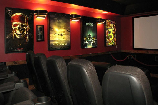home theater with poster frames